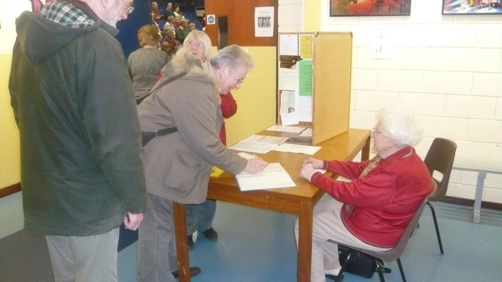 picture of 2 people signing in